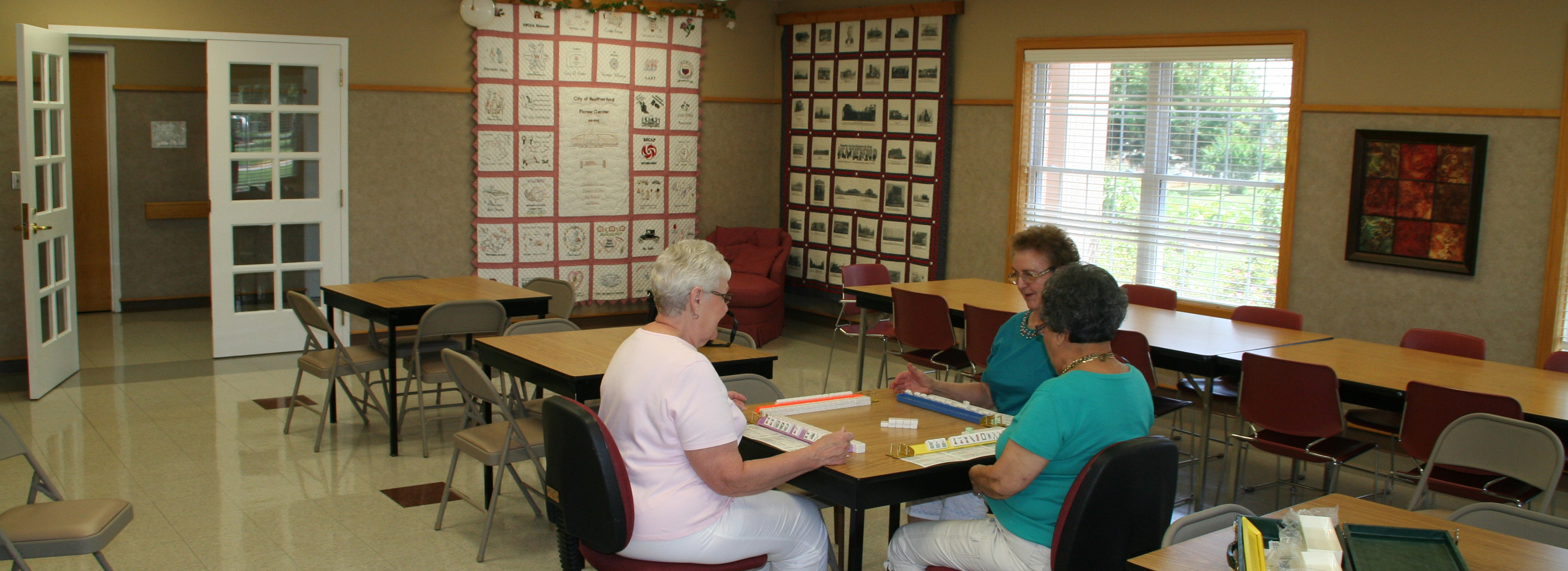 women playing games in the activity room at the Pioneer Center