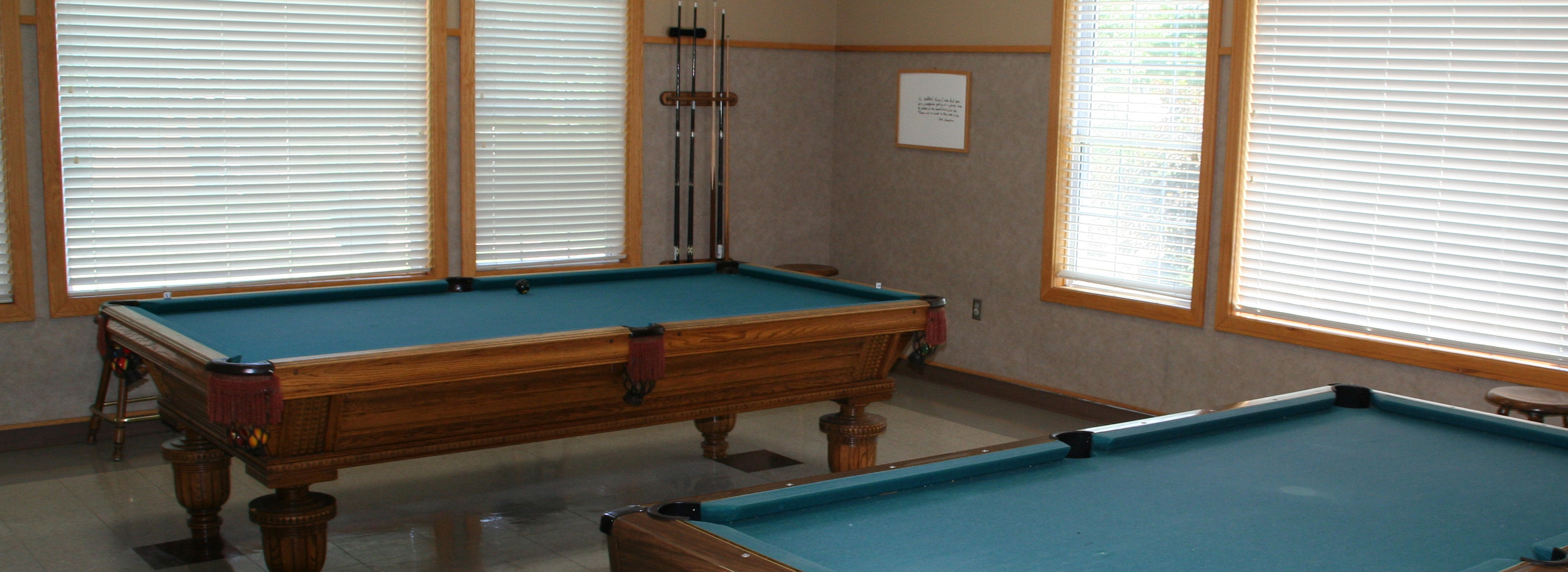 pictures of a couple of pool table at the Pioneer Center